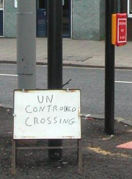 `UN CONTROLLED CROSSING' sign